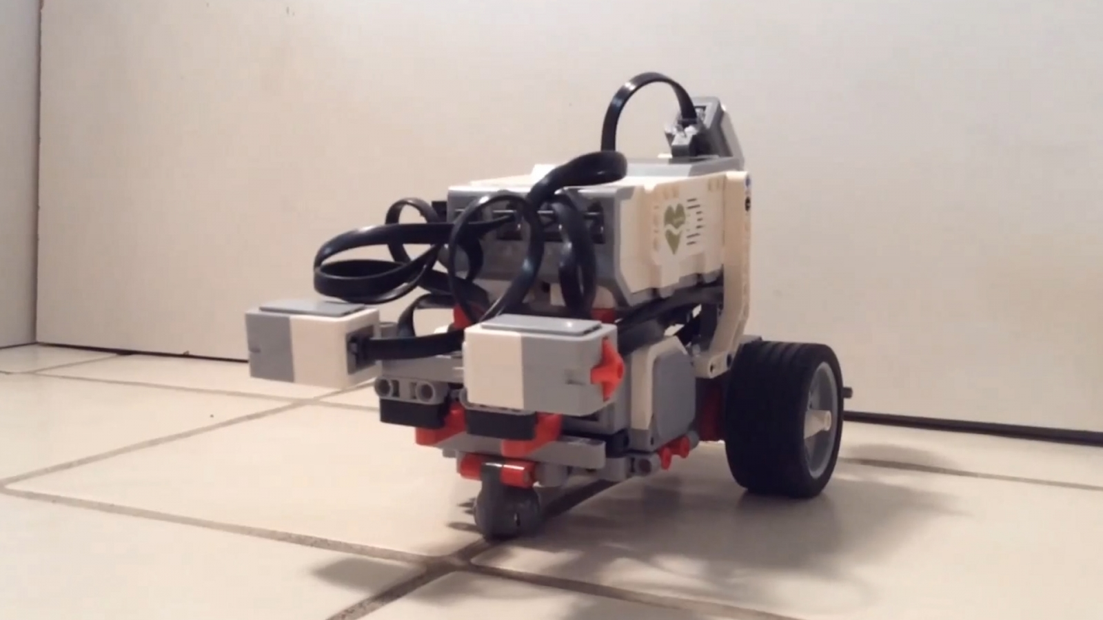 LEGO robot controlled by the brain of a worm developed by OpenWorm project