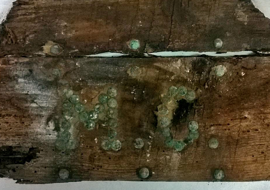 The remains of a wooden casket marked with the initials MC. The coffin could have housed the remains of Miguel de Cervantes