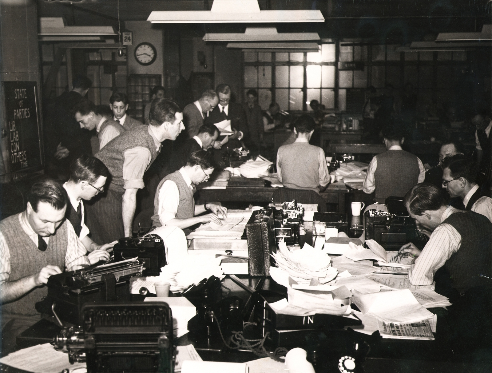 A file photo from the Reuters archive shows journalists in the Reuters Newsroom at 85 Fleet Street, London, during the British General Election of 1950
