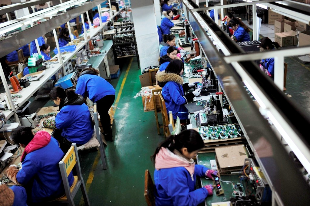 China's 2014 factory profit growth at two-year low