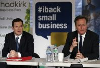 Britain\'s Prime Minister David Cameron (R) sits with Chancellor George Osborne during a meeting with local small business owners in Stockport, northern England January 9, 2015.