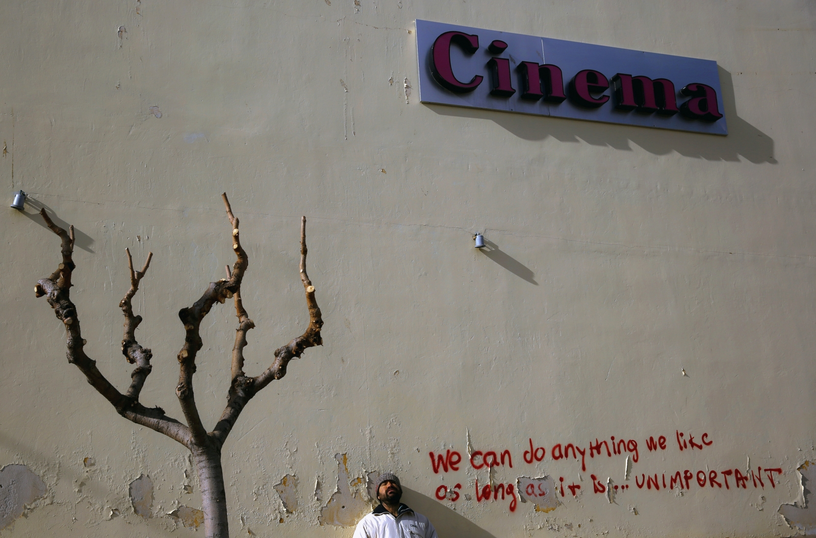 Michael, 36-year-old and unemployed, poses by an abandoned open-air cinema in central Athens February 8, 2013. Michael worked as a hotel clerk for over fifteen years but when the hotel closed he was unable to find work and in late 2011 became homeless.