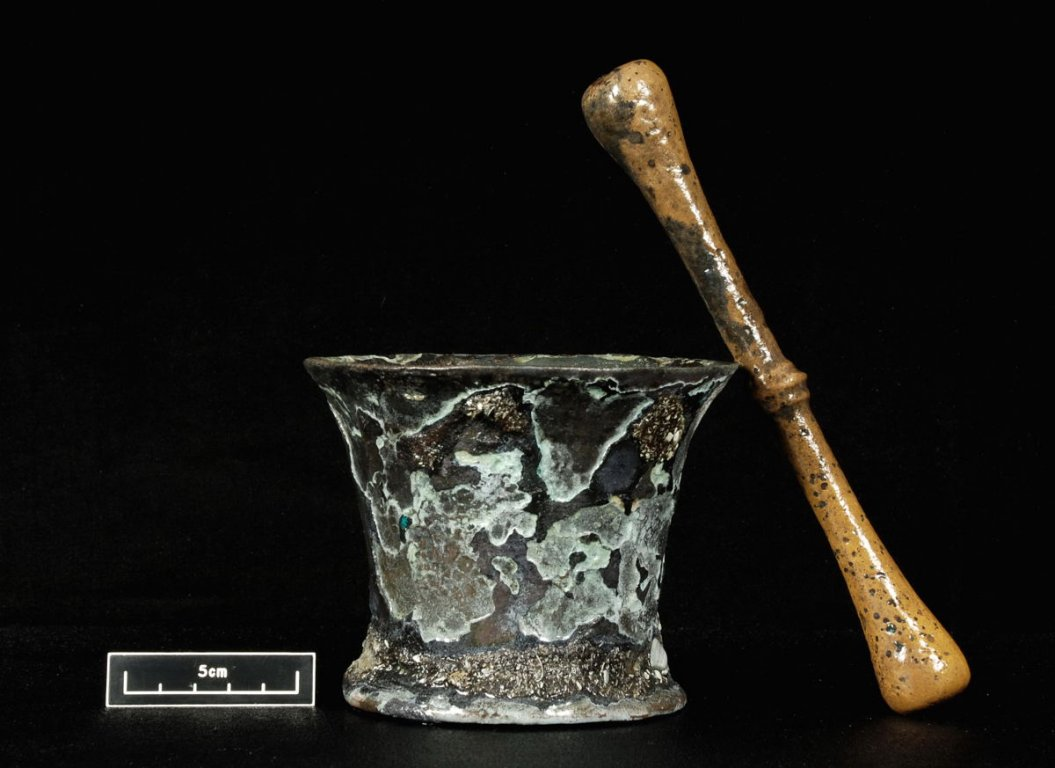 A mortar and pestle made from cast brass