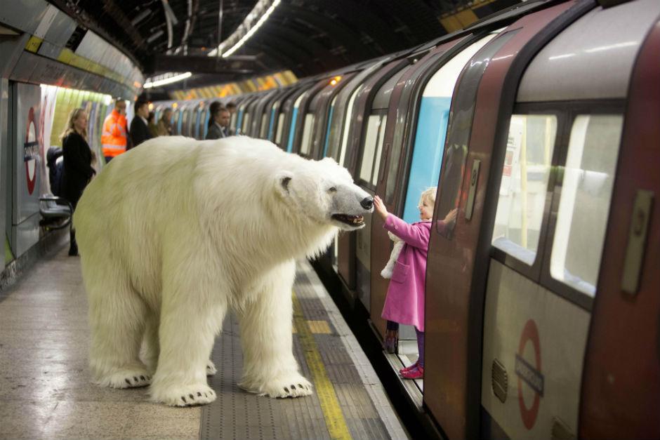 Giant polar bear rides on London Underground