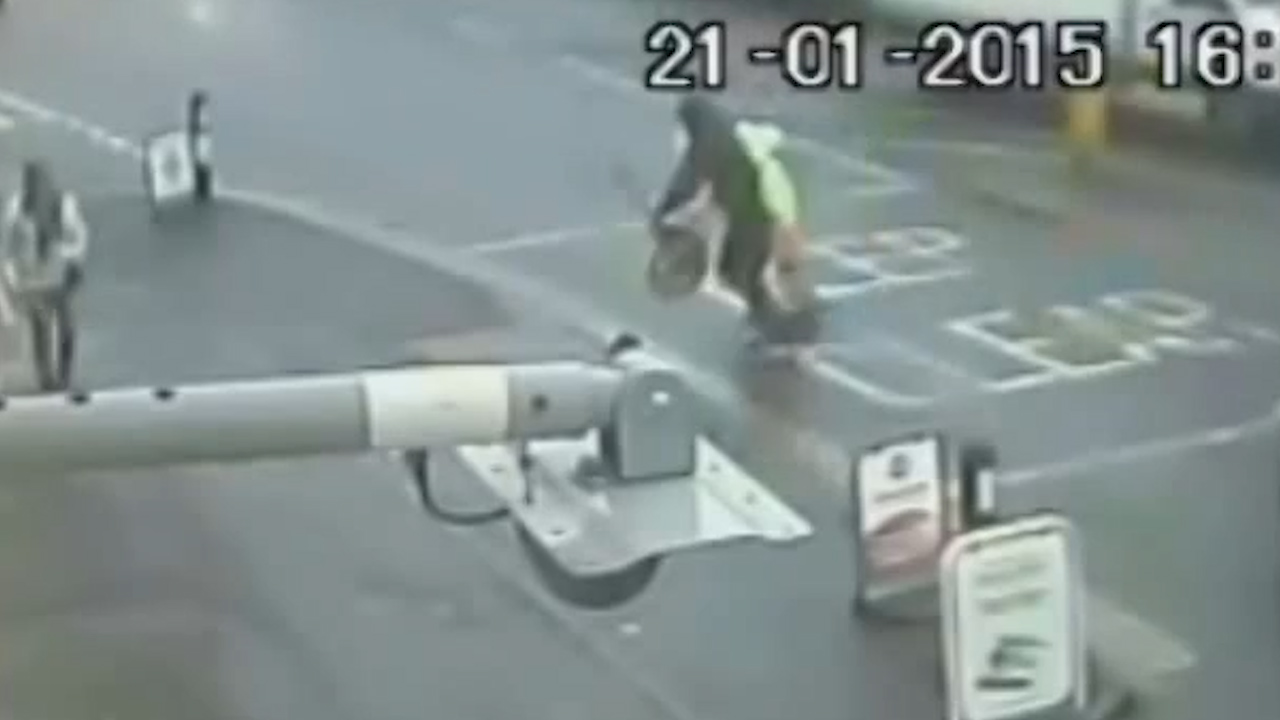 Shocking video shows lollipop man assaulted and robbed of his stick