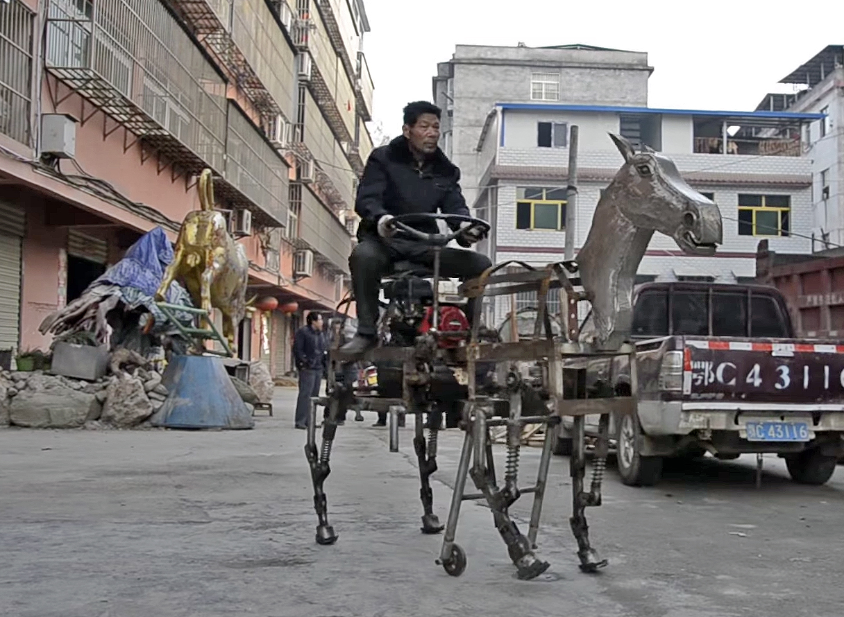 Chinese inventor Su Daocheng drives his robotic horse through the streets of Shiyan in Hubei