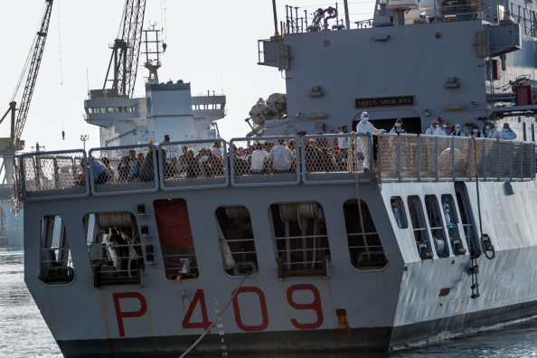 Rescued Syrian refugees arrive in Palermo, Italy, on board an Italian coast guard boat. (Getty)