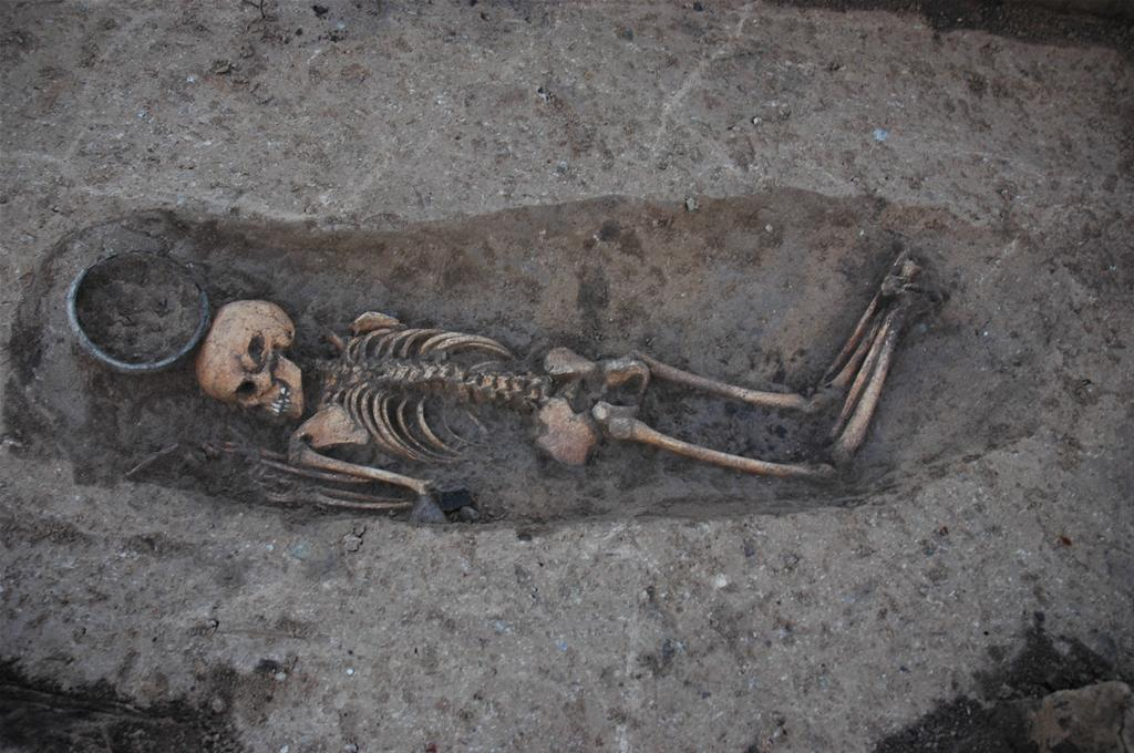 A young woman (16 years old) lying on her stomach in the grave, buried with pottery