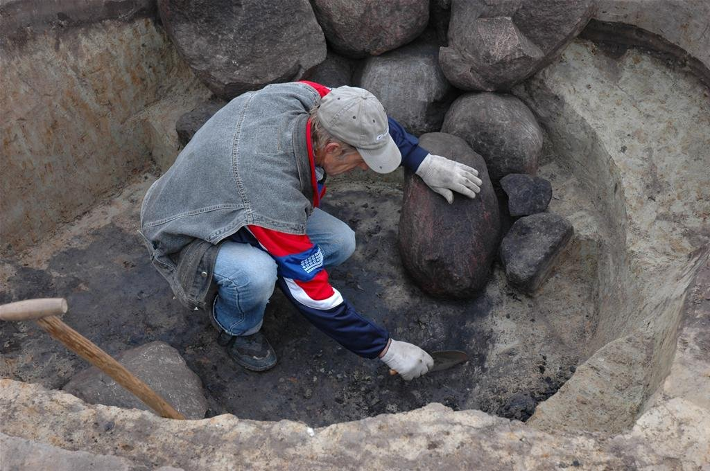 An archaeologist excavating one of the