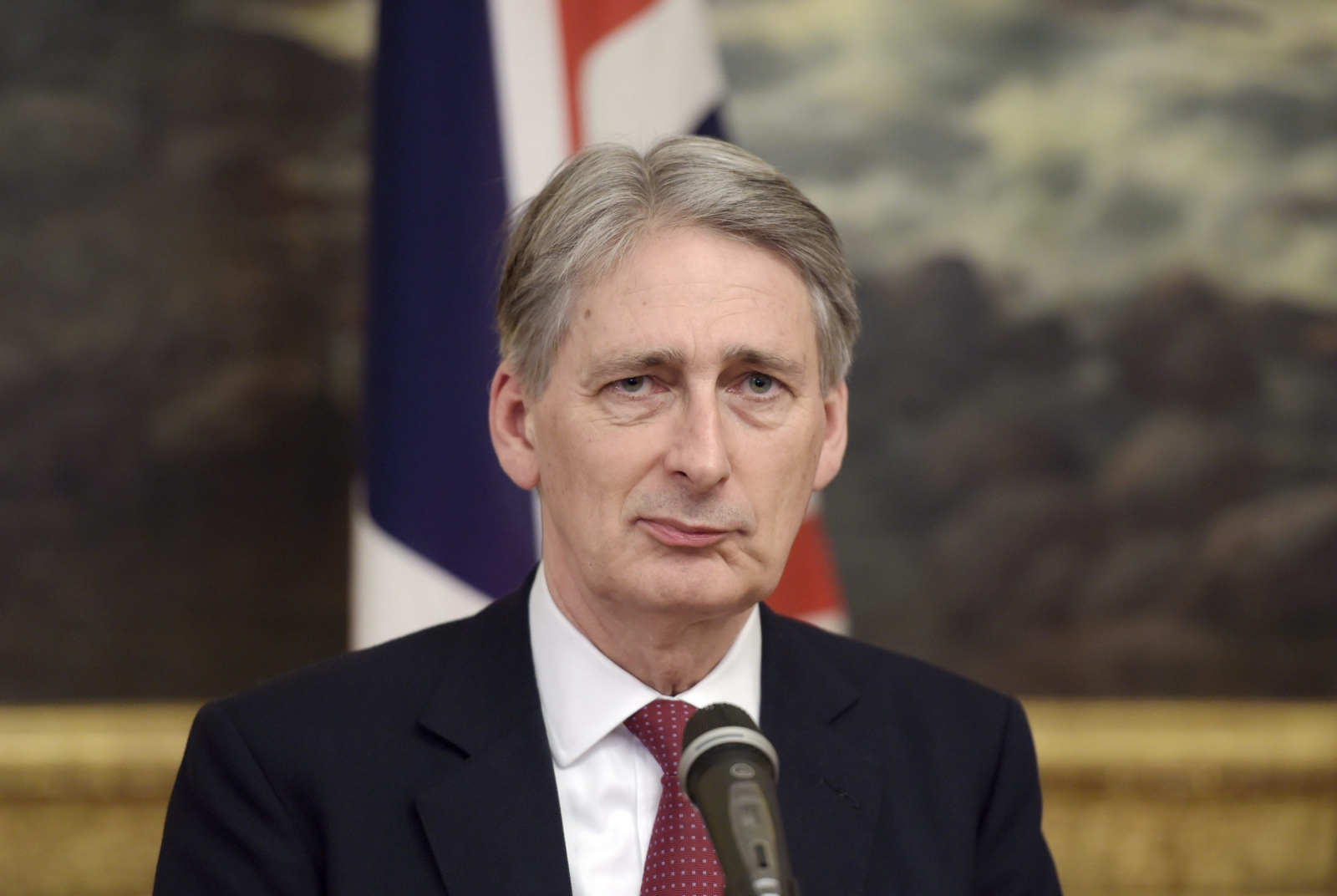 British Foreign Secretary Philip Hammond pauses as he speaks during a meeting with Finnish Foreign Minister Erkki Tuomioja (not pictured) in Helsinki, January 8, 2015