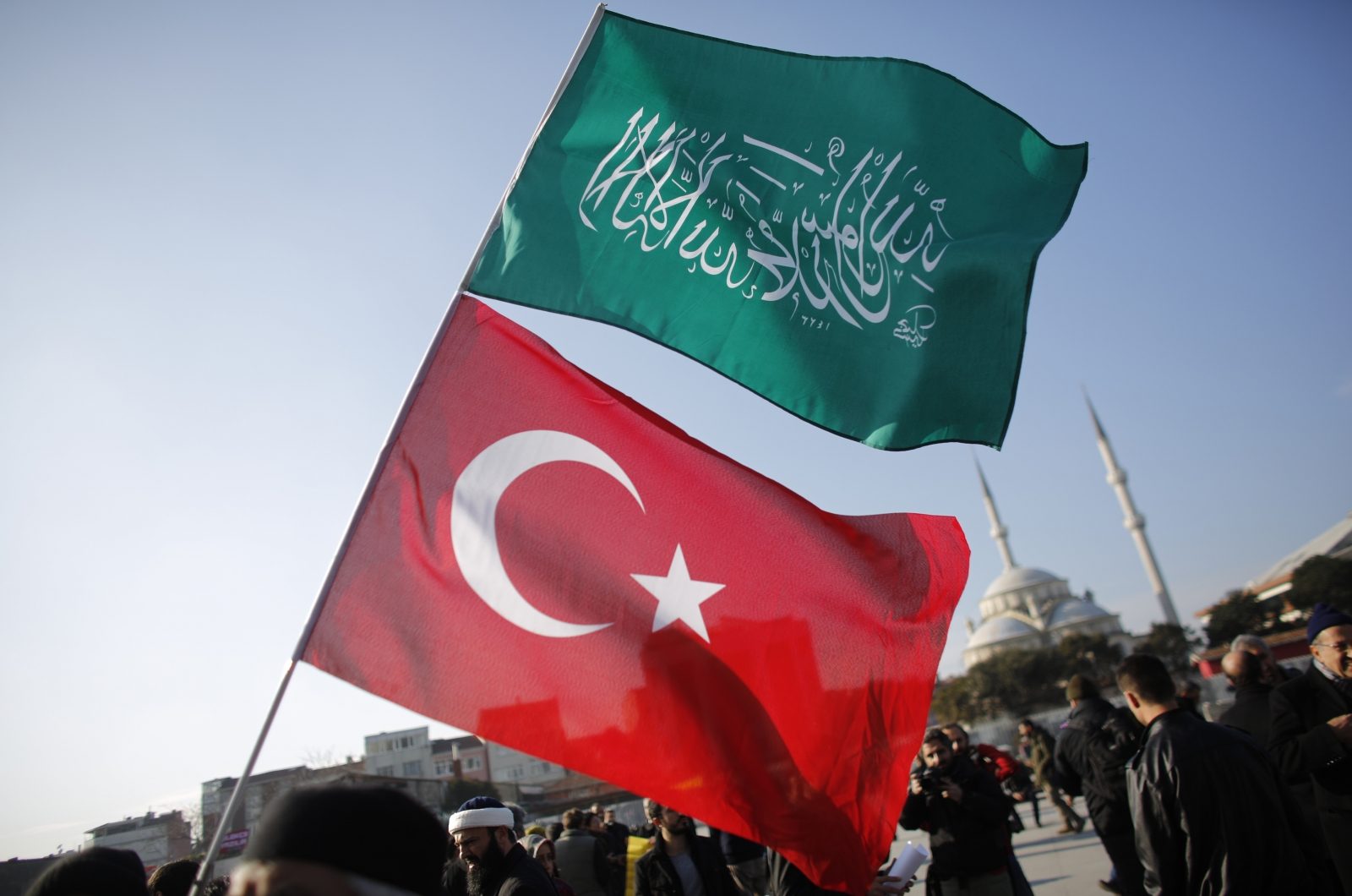 A demonstrator waves Turkish and Islamic flags during a protest against Cumhuriyet, a staunchly secular opposition newspaper, in Istanbul January 15, 2015. Pro-Islamist demonstrators protested against Turkish daily newspaper Cumhuriyet which published a f