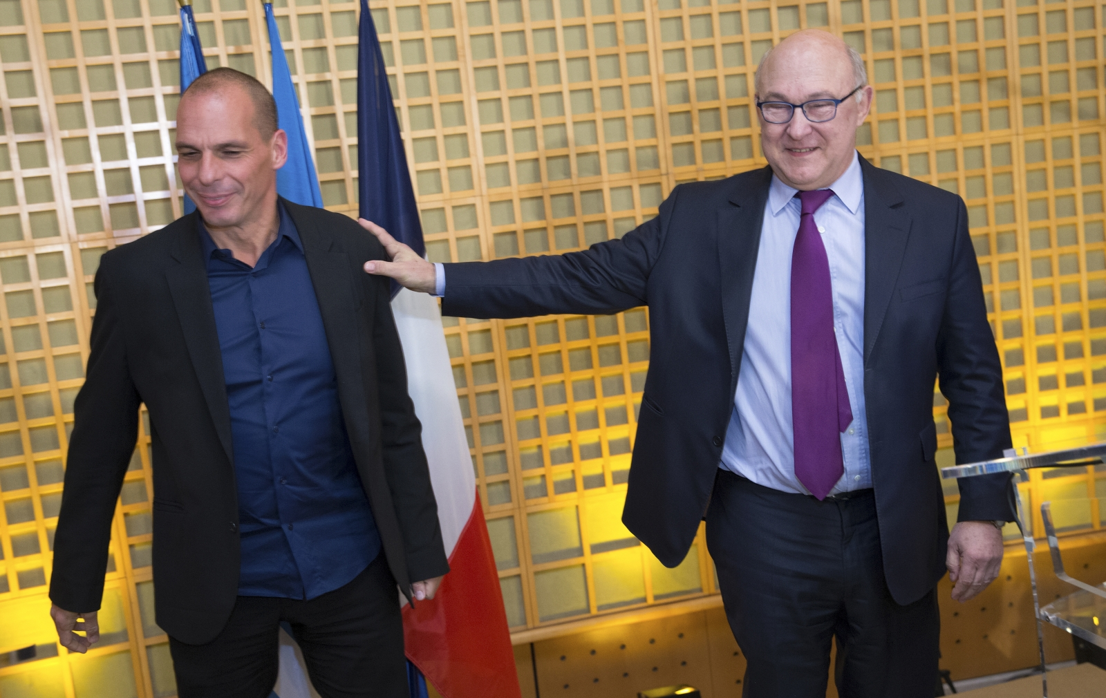 French Finance Minister Michel Sapin  and Greek Finance Minister Yanis Varoufakis