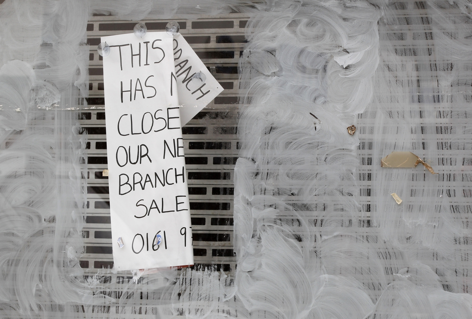 A notice is displayed in the window of an empty shop in Altrincham, northern England,