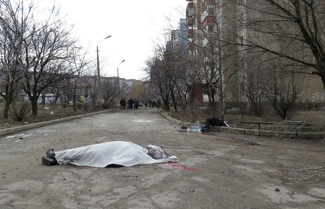 The bodies of victims are seen outside a building neighbouring a hospital in Donetsk