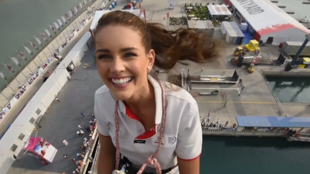 Miss World climbs 100ft boat mast in China