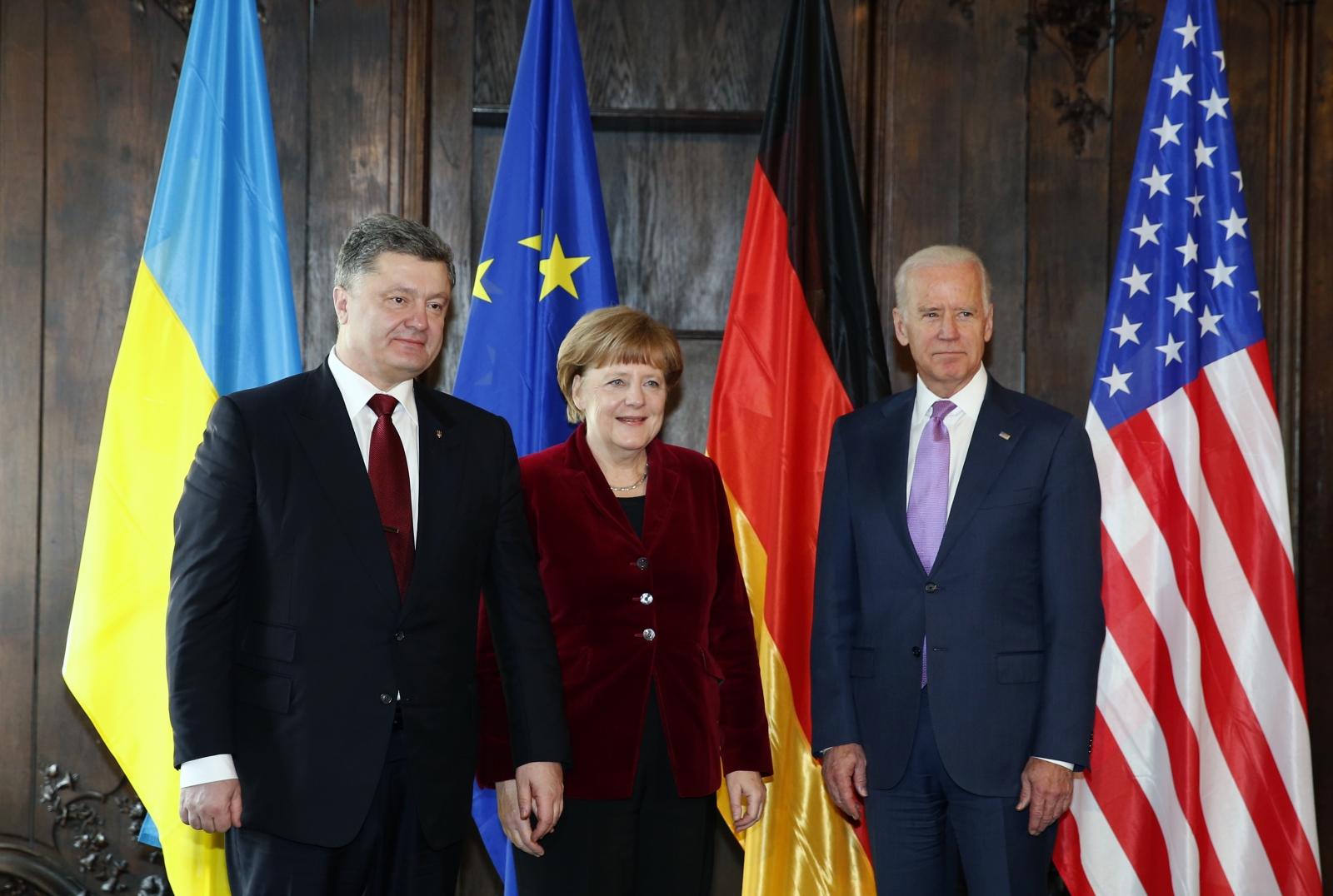 Ukraine's President Petro Poroshenko, German Chancellor Angela Merkel and U.S. Vice President Joe Biden (L-R) pose during the 51st Munich Security Conference