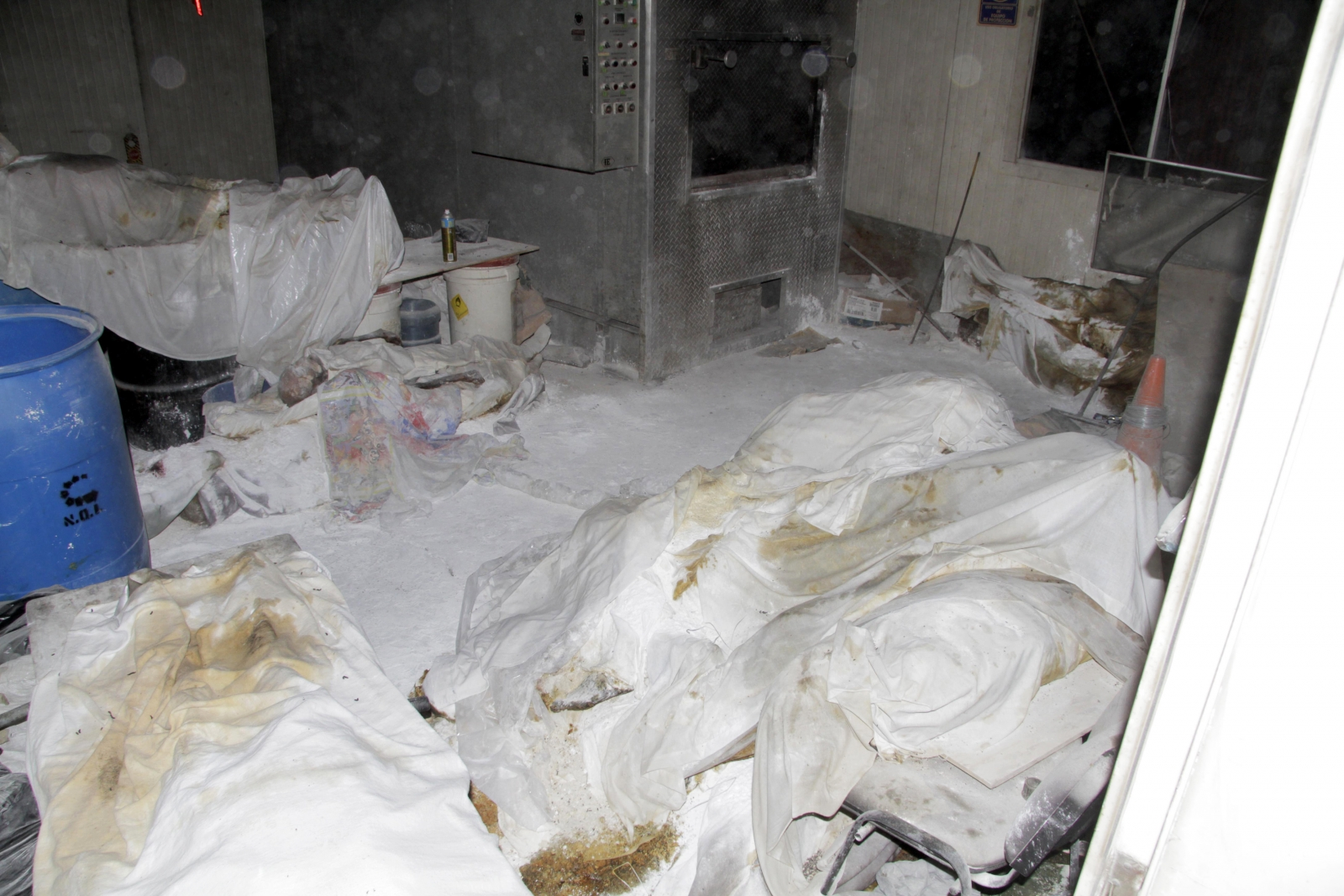 Covered dead bodies are seen at a crematorium in Mexico