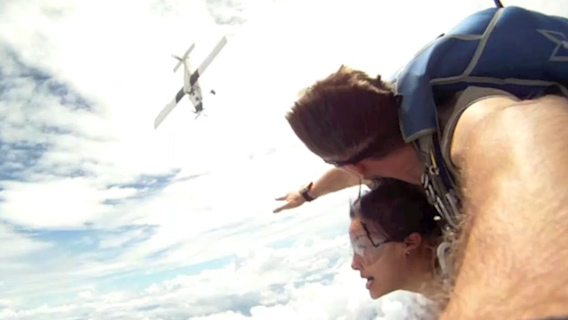 Video: Skydivers narrowly miss plane's propellers during freefall
