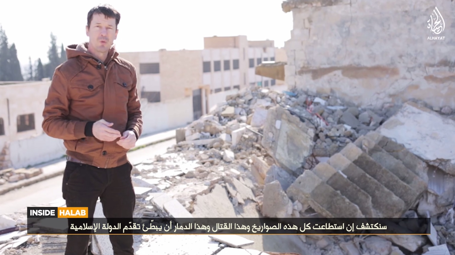 British hostage John Cantlie appears in an Isis video recorded in Aleppo, Syria.