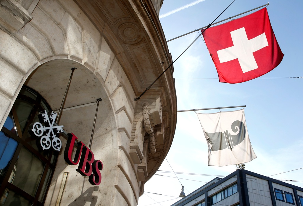 UBS's stock drops as it warns on impact of Swiss franc might