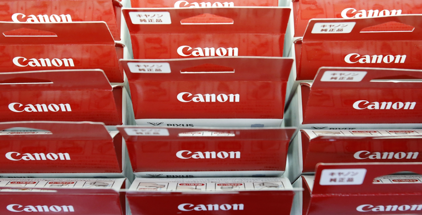 Canon's logos are pictured on printer ink packages displayed at an electronics retail store in Tokyo