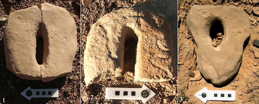 Vulvas carved in stone in what archaeologists believe may be a fertility and death cult site.