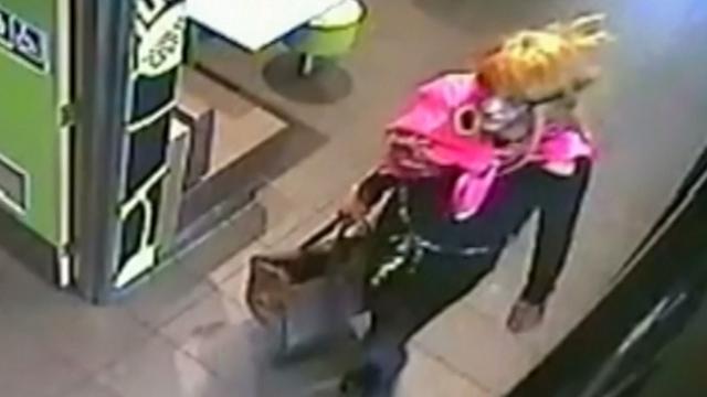 Australian detectives release video of cross-dressing robber
