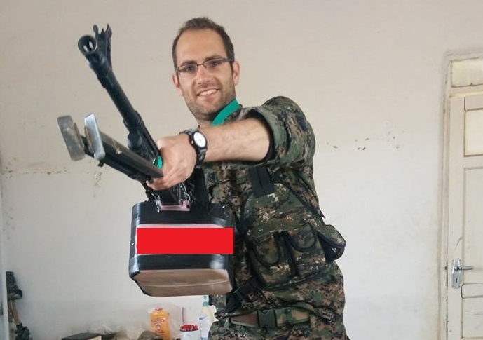 Former Young Conservative Baran Macer poses with heavy weapon in Syria
