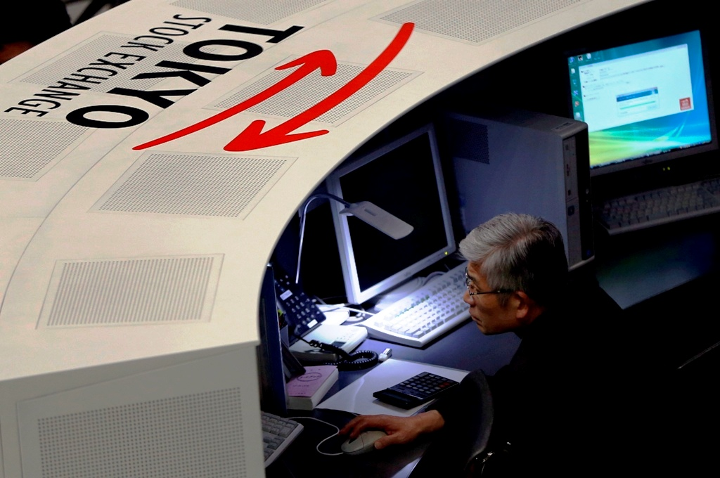 Japan: Nikkei ends at seven-and-a-half year high