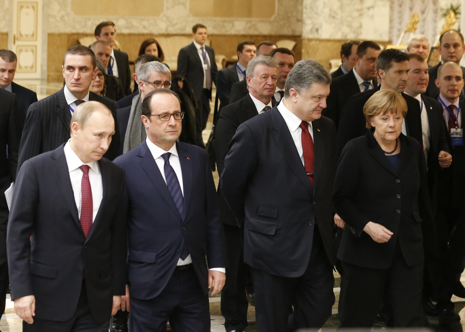 Russia's President Vladimir Putin (L, front), Ukraine's President Petro Poroshenko (2nd R, front), Germany's Chancellor Angela Merkel (R, front) and France's President Francois Hollande (2nd L, front) walk during peace talks in Minsk,