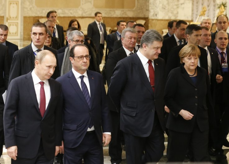 Russia's President Vladimir Putin (L, front), Ukraine's President Petro Poroshenko (2nd R, front), Germany's Chancellor Angela Merkel (R, front) and France's President Francois Hollande (2nd L, front) walk during peace talks in Minsk,