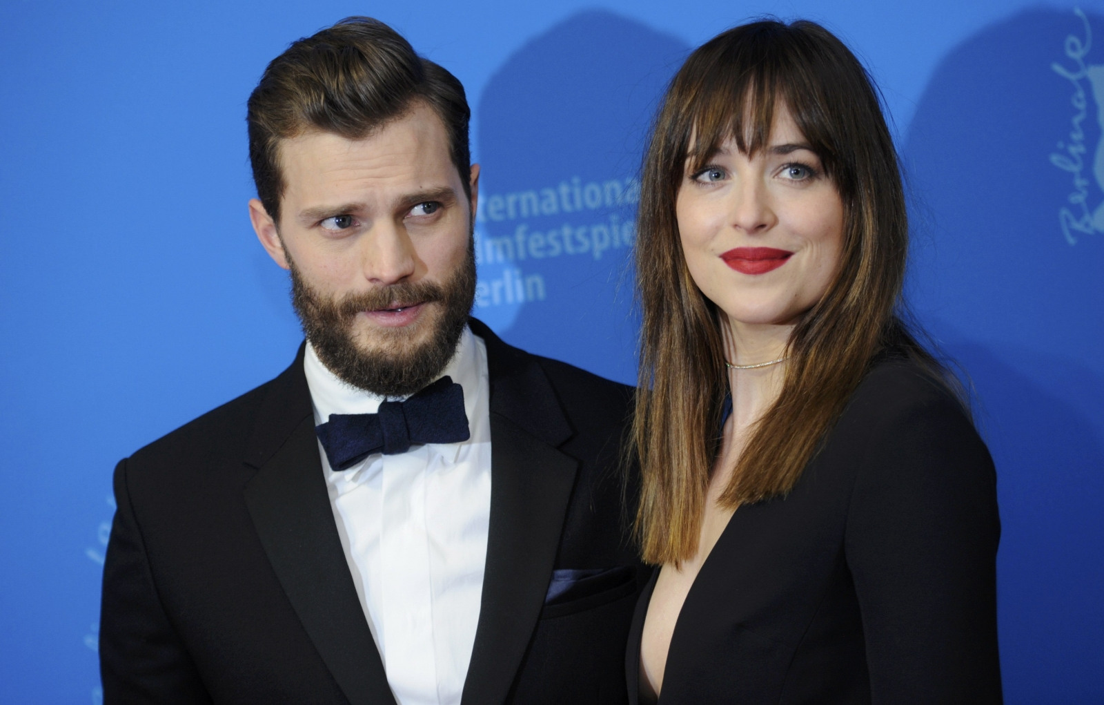 Jamie Dornand and Dakota Johnson face frenetic fans as Berlin hosts world premiere of Fifty Shades of Grey