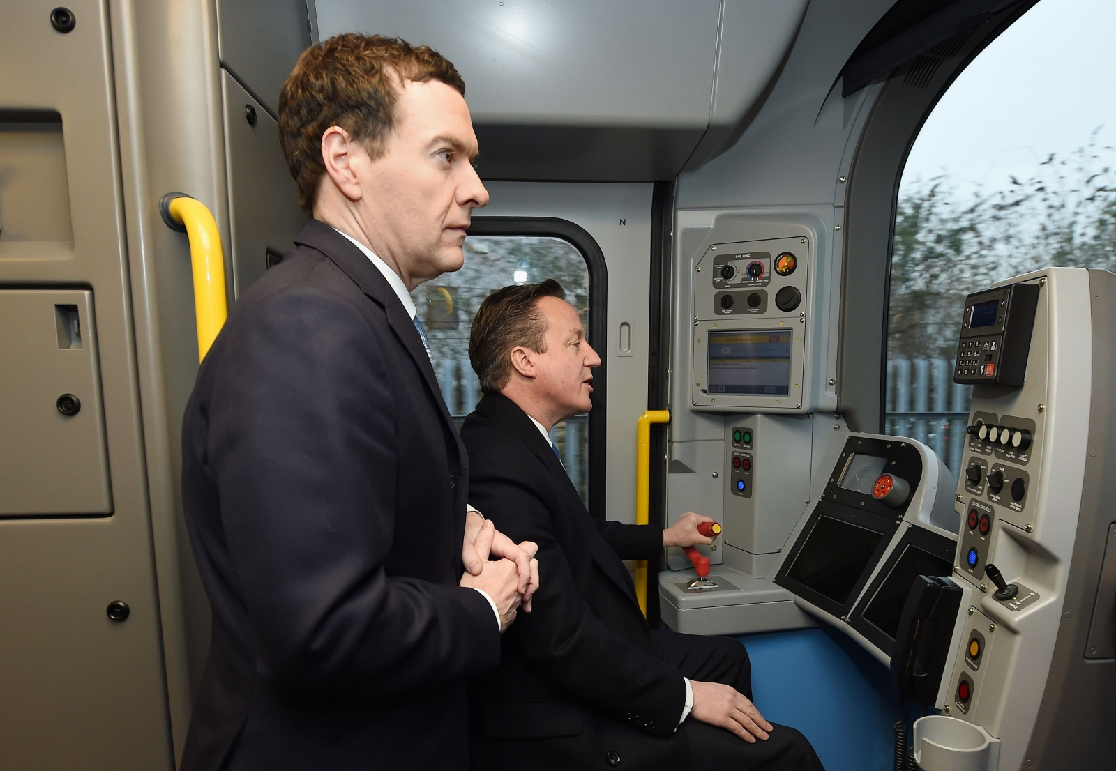 General Election 2015: David Cameron drives train to show country on track