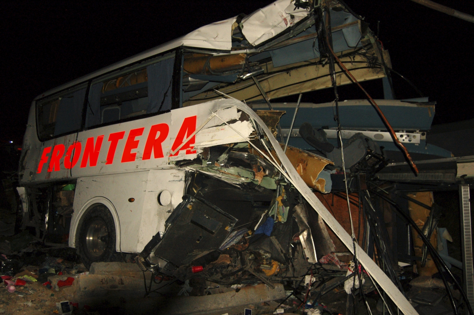 The wreckage of a passenger bus is seen at the site of an accident in Anahuac, Nuevo Leon state