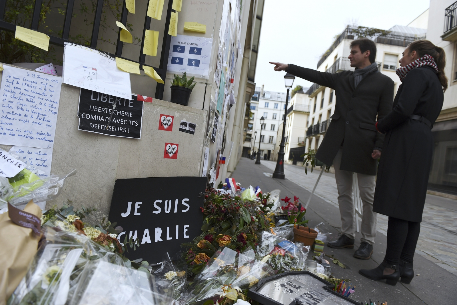 Flowers and tributes laid outside the offices of French satirical magazine Charlie Hebdo, the day after a deadly attack on a freedom of speech debate in Copenhagen. (Getty)