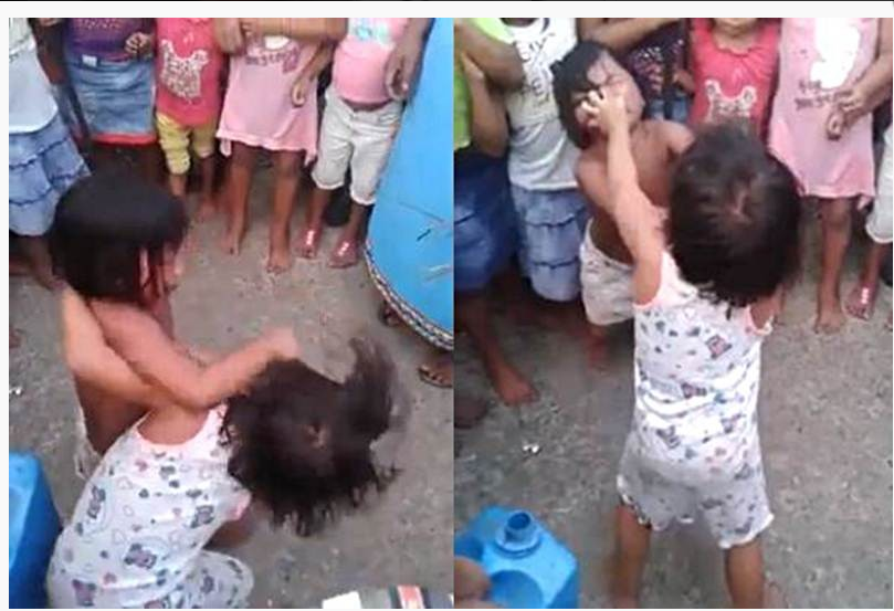 The viral video shows mothers encouraging two young girls to fight savagely