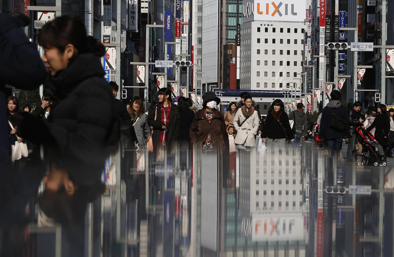 Japan economy grows 2.2 percent rebounding from recession