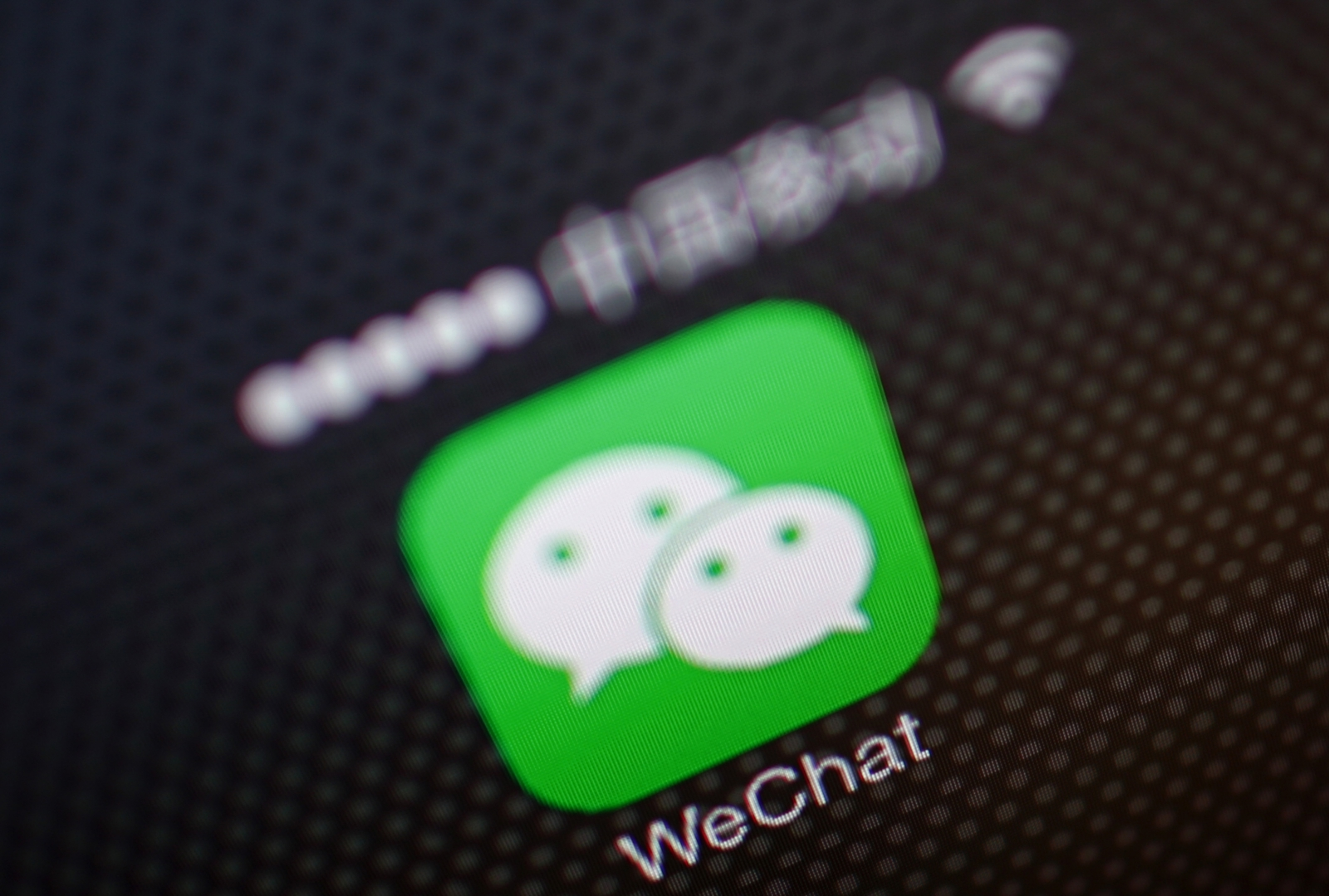 A picture illustration shows a WeChat app icon in Beijing