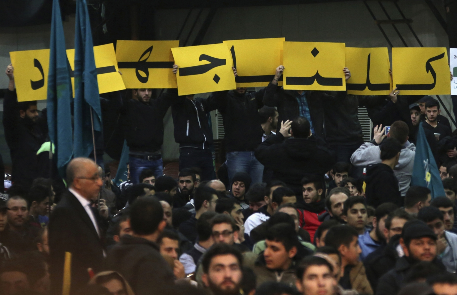 Supporters of Lebanon's Hezbollah leader Sayyed Hassan Nasrallah hold up placards during a rally
