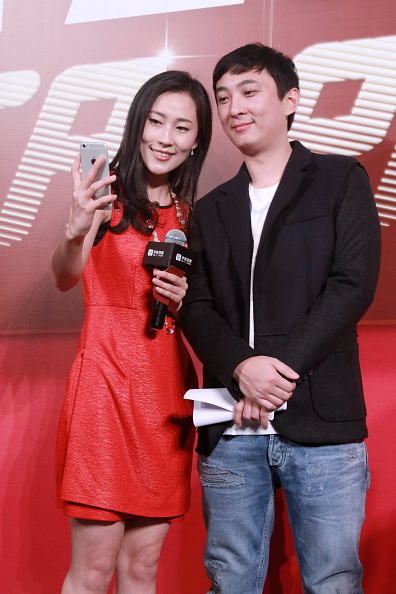 Wang Sicong poses with a fan. (Getty/ChinaFotoPress)