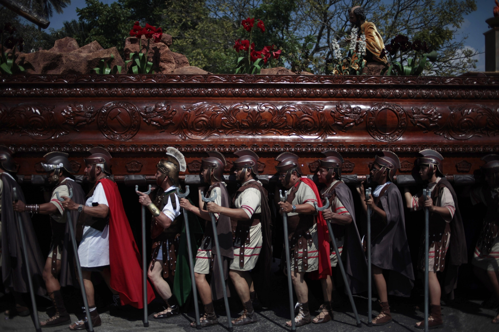 Men, dressed in traditional Roman costumes, carry a statue of Jesus Nazareno during a procession to mark the second Sunday of Lent, in the streets of Guatemala City
