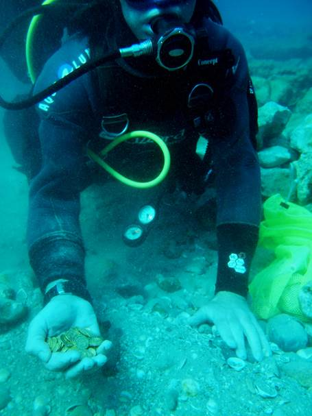 Scuba divers picked out what they thought was a toy coin, only for it to be confirmed as a genuine ancient gold coin.