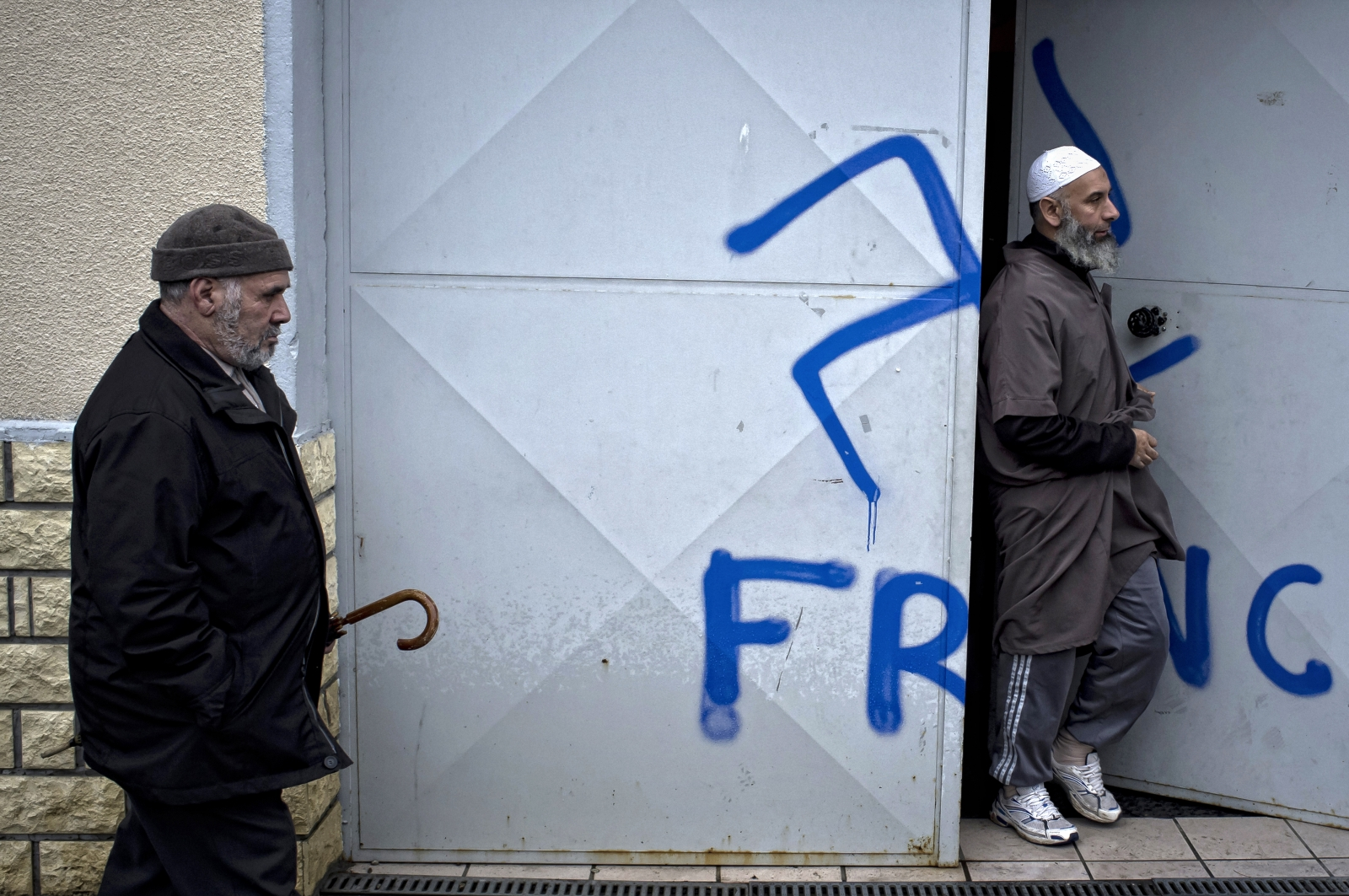 Racist graffiti scrawled on the doors of a Lyon mosque (Getty)