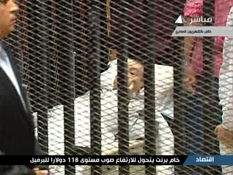 Hosni Mubarak is seen on a hospital bed in the courtroom for his trial at the Police Academy in Cairo in this still image taken from video