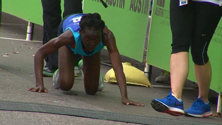 Elite marathoner refuses to quit and crawls across finish line