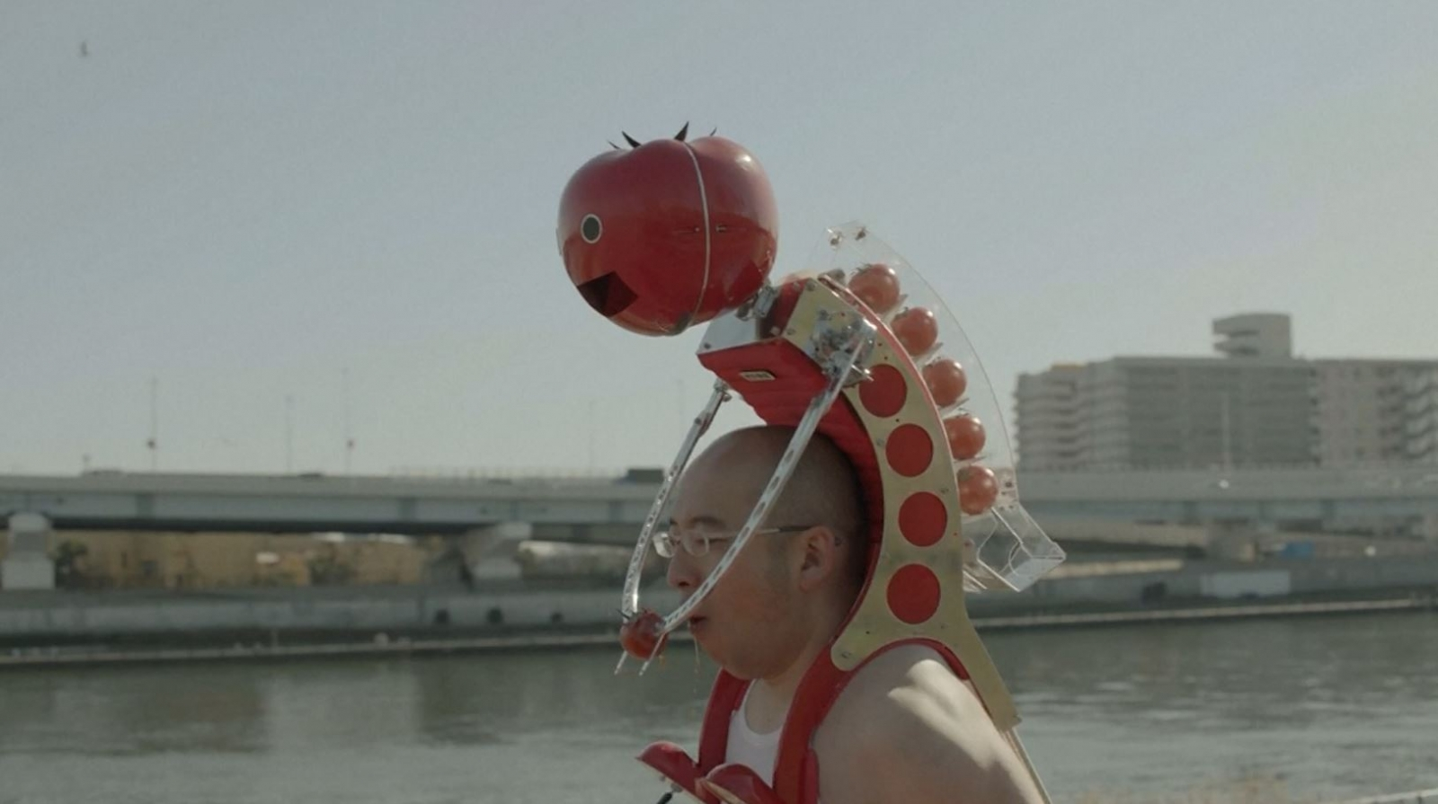 Meet Tomatan, a wearable robot that feeds you tomatoes as you run