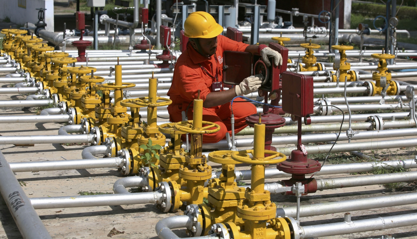 An engineer of Oil and Natural Gas Corp (ONGC) works inside the Kalol oil field in the western Indian state of Gujarat