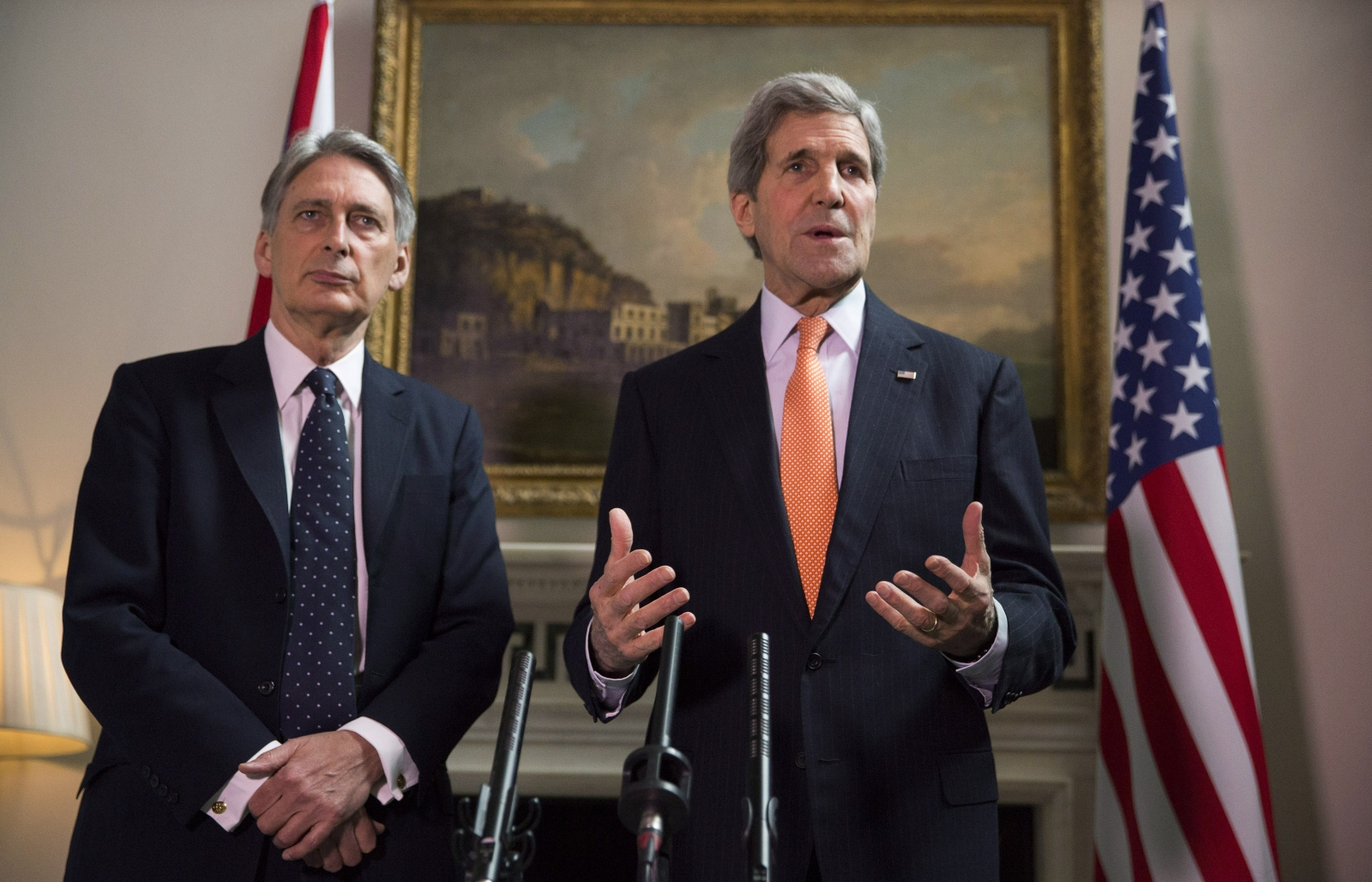 Britain's Foreign Secretary Phillip Hammond and U.S. Secretary of State John Kerry (R) deliver a statement at a press conference in London