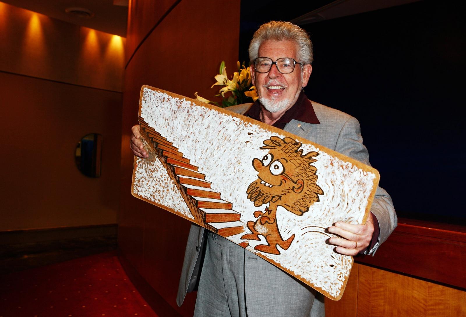Rolf Harris stripped of national honours in native Australia