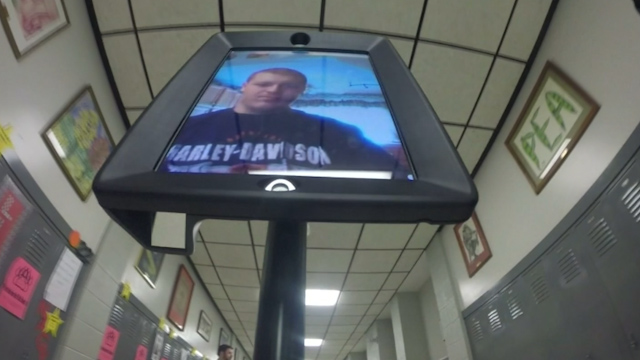 Robot attends school in place of injured student
